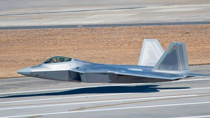 Photo of a low flying F-22